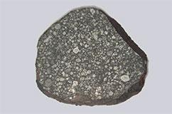 Det er lykkedes forskerne meget præcist at datere alderen på klippeplaneternes byggesten, de såkaldte kondruler der findes som millimeter-små glasagtige kugler i primitive meteoritter. Foto Center for Stjerne- og Planetdannelse.