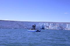 Nicolaj Larsen and Anders Bjørk working on a drilling platform bv the Helheim  glacier in Southeast Greenland. Photo: Kurt Kjær